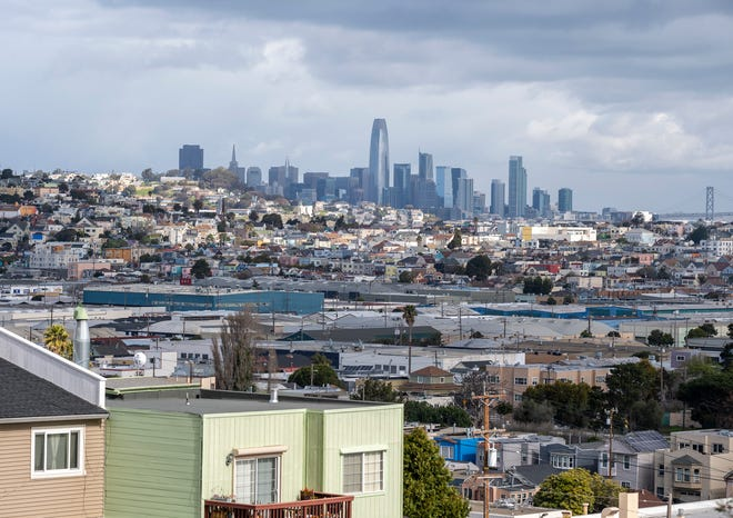 A sea of homes below the skyline is photographed from the Bayview Park in San Francisco on Tuesday, March 9, 2021.