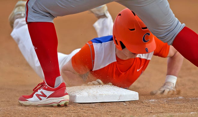 Central's Landon Cowley (8) dives back into first base during a game against Odessa on Tuesday, March 9, 2021.
