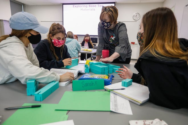 Stefanie Livers, standing, works with students in the College of Education Program on base ten blocks which are used to teach children math during the Elementary Math Methods course at Missouri State University on Wednesday, March 10, 2021.
