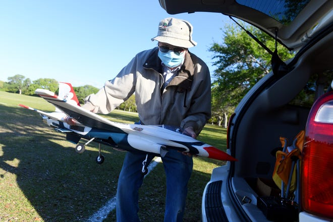 Tom Chytil prepares his remote-controlled model airplane of a U.S. Air Force Thunderbird for flight on Wednesday, March 10, 2021, at Riverside Park in Vero Beach. Chytil is a member of the Quiet Birds of Vero Beach, a group of about a dozen remote-controlled airplane enthusiasts that meets three time a week at the park.