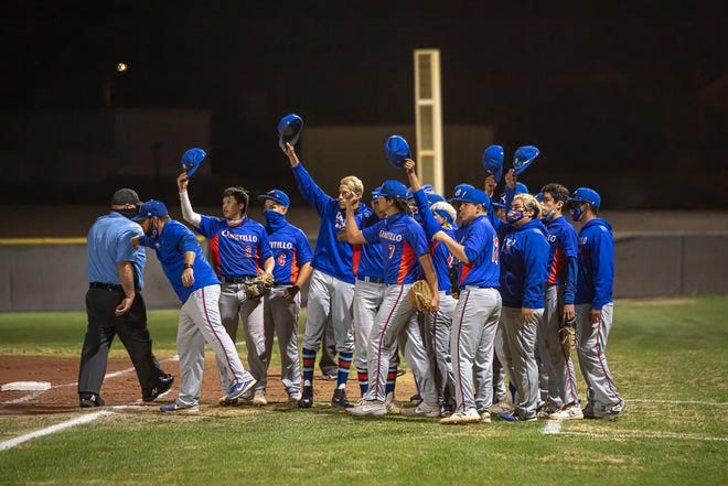 Canutillo players wave their hats to the opposing team at the end of the game. Canutillo High School narrowly defeated El Dorado 1-0 at El Dorado High School on March 10, 2021.