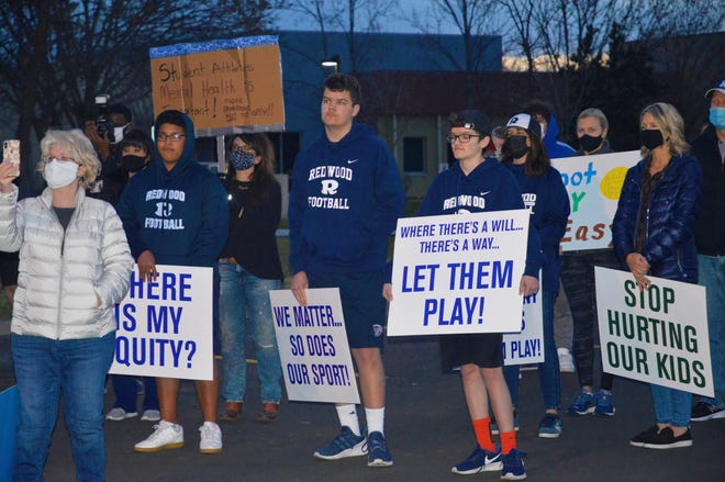 About 70 students and parents protested VUSD's decision to cancel high school football and water polo on March 9, 2021 at the district's office.