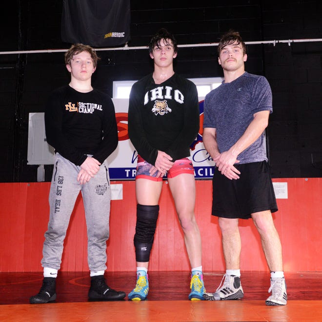 New Lexington's Kody Beal, left, Wyatt Abele and Shaun Pletcher will wrestle in the Division II state tournament this weekend at Sparta Highland.