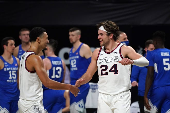 Gonzaga Bulldogs forward Corey Kispert (24) and guard Jalen Suggs (1) celebrate during the second half of the West Coast Conference Tournament championship game against the BYU Cougars at Orleans Arena.