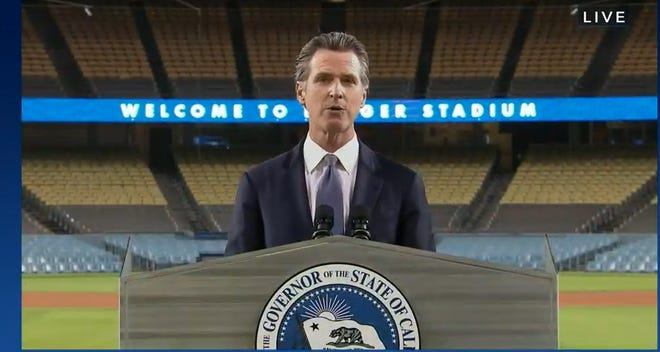 """Gov. Gavin Newsom delivers his """"State of the State"""" speech at Dodger Stadium on March 9, 2021."""