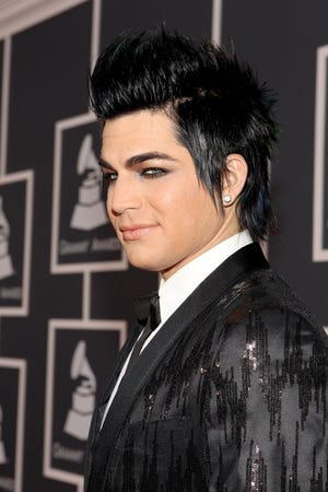Adam Lambert praises Lil Nas X while reflecting on his own gay kiss at the 2009 American Music Awards.