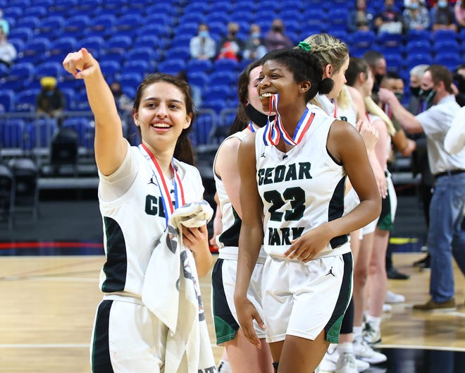Cedar Park seniors Sarai Estupinan and Alisa Knight celebrate the Timberwolves' win over defending champion Frisco Liberty in the Class 5A state championship game Wednesday at the Alamodome in San Antonio.