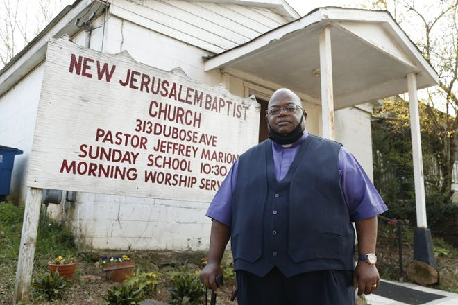 The Rev. Jeffrey Marion stands outside New Jerusalem Baptist Church in Athens. A GoFundMe campaign has raised enough money for a new roof.