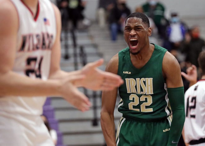 STVM's Malaki Branham celebrates during the first half of a Division II regional semifinal against the Struthers Wildcats, Thursday, March 11, 2021, in Barberton, Ohio. [Jeff Lange/Beacon Journal]