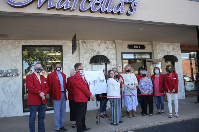 Ribbon cutting for Marcella Furs & Leather, located at 2611 Wolflin Village.