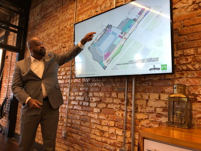 H.B. Brantley, a managing principal of the Atlanta construction and development firm H.J. Russell & Co., points out features of the new James Brown Arena on Thursday at the Augusta Convention and Visitors Bureau.