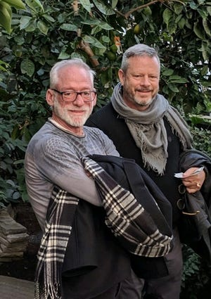 Richard Justice, an LGBT and Black Lives Matter activist whose career in Augusta theater spanned three decades, died from COVID-19 in August. He is seen here with his partner of more than 23 years, Terence Leegan.