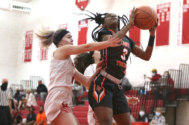 Beaver Falls' J'La Kizart (right) goes for a layup while being guarded by Mohawk's Jordan Radzmynski (left) during the first half of the WPIAL Class 3A Semifinals Wednesday night at Mohawk High School.