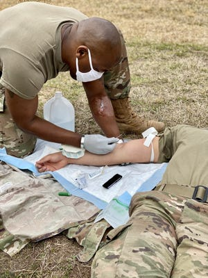 Sgt. 1st Class Sidney Pirtle, Pleasant Hill, Calif. Recruiting Station administers an IV to Spc. Cruz Espinosa, 5th Battalion, 25th Field Artillery Regiment, 3rd Brigade Combat Team, 10th Mountain Division during the Emergency Medical Technician training conducted by the Bayne-Jones Army Community Hospital Education Division at Fort Polk, La. on Feb. 24