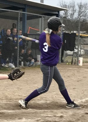 Hayley Lunsford follows through on a swing which resulted in a triple against Cedarville last Tuesday. The junior was 3-for-4 with 4 RBIs and 4 runs scored in the Ladycats' 23-1 win.