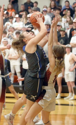 Boonville senior Kourtney Kendrick drives to the basket in the second half Wednesday night against Macon in a Class 4 sectional playoff game in Macon. Kendrick scored a game-high 20 points in a 64-52 win over the Tigers.