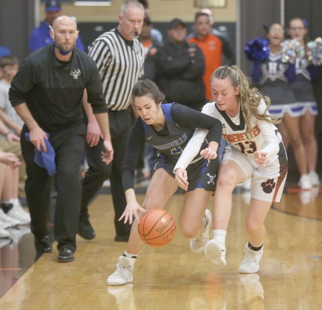 Boonville senior Kennedy Renfrow picks up a steal in the first half Wednesday night against Macon in a Class 4 sectional playoff game in Macon. The Lady Pirates beat Macon 64-52 to advance to the quarterfinal round of the state tournament Saturday, March 13 in Boonville. Tip-off for the game is 1 p.m.