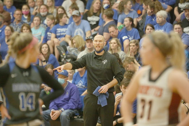 Boonville Lady Pirates basketball coach Jaryt Hunziker encourages the players during a free throw attempt in the second half Wednesday night against Macon in a Class 4 sectional playoff game in Macon.