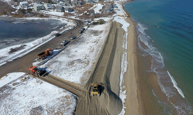 Excavators haul sediment to replenish dunes that have been hard hit by erosion at Town Neck Beach in Sandwich. Public comment is open on a U.S. Army Corps of Engineers plan to do further renourishment at the beach. [Steve Heaslip/Cape Cod Times file]