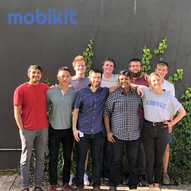 The Mobikit team with CEO Arnab Nandi, second from right in front row.