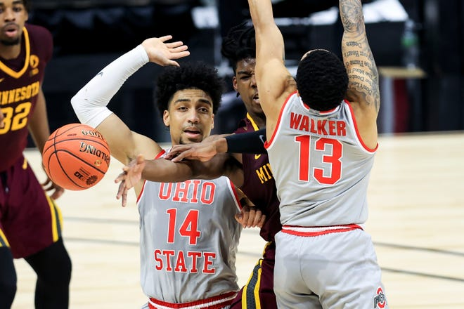 Mar 11, 2021; Indianapolis, Indiana, USA; Ohio State Buckeyes forward Justice Sueing (14) reacts as Minnesota Golden Gophers guard Marcus Carr (5) passes the ball against Ohio State Buckeyes guard CJ Walker (13) in the first half at Lucas Oil Stadium. Mandatory Credit: Aaron Doster-USA TODAY Sports