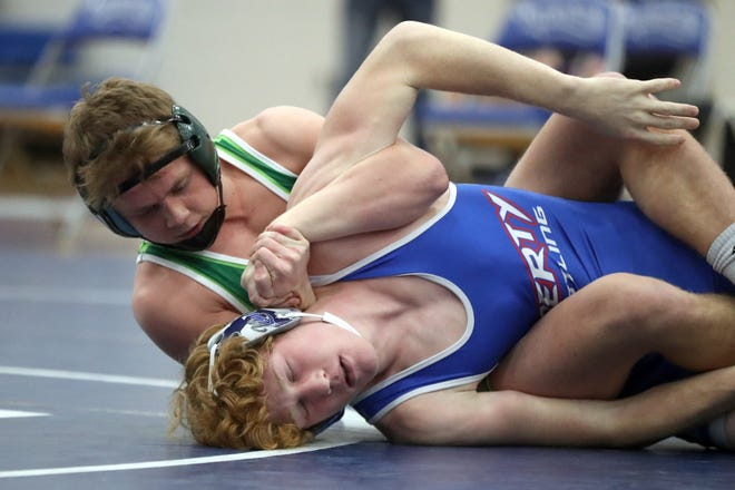 Jimmy Baumann of Dublin Coffman, top, here controlling Gabriel Pence of Olentangy Liberty in a 152-pound match in January, is looking for a top-eight finish in this weekend's state wrestling tournament, a year after missing out on competing because COVID-19 canceled the state meet.