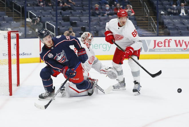Jack Roslovic, here trying to pass against Detroit on March 2, was bumped from the Blue Jackets' top line Tuesday, and coach John Tortorella is questioning the center's effort level.