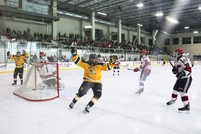 Upper Arlington's Sam Burns (42) celebrates a first-period goal by his teammate Max Robins in the Golden Bears' 2-1 victory over St. Charles to earn a state tournament berth.