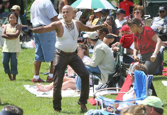 Robert Spriggs, also known as Babachu Spriggs, dances to the music during the Jazz & Rib Fest at the Bicentennial Park stage in 2007.