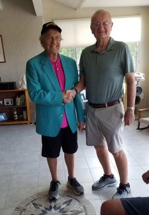 Don Bang, wearing the coveted green jacket after winning the Senior Castle Tour event in Sun City, Ariz. on March 7, poses next to last year's winner, Bill Montague.
