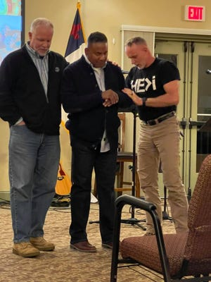"""Retired Marine Sgt. Maj. Keith Long, center, gets """"prayed up"""" with Tun Tavern Fellowship  executive director Mike West (left) and Dr. Jeff Curry before speaking at one of the Marines' sessions at White Sulphur Springs, Pa., the weekend of Feb. 26."""