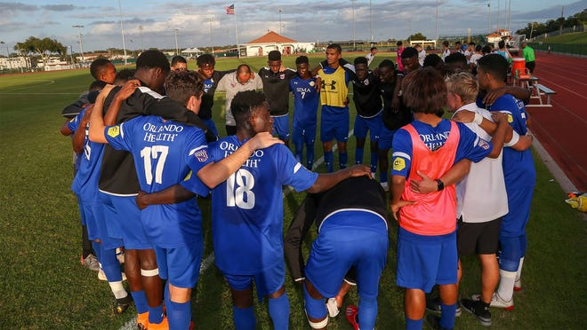 Members of the Montverde Academy soccer program huddles after a recent practice.
