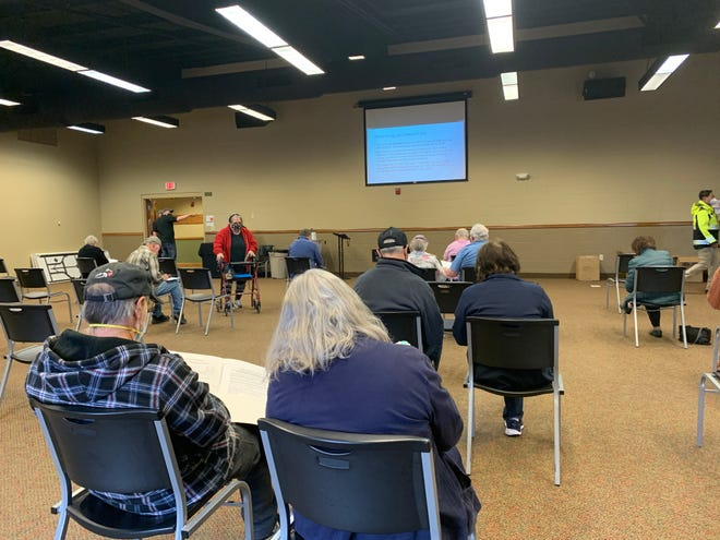 Vaccine participants receive education about the COVID-19 vaccine before getting their first shot at Wooster Nazarene Church.
