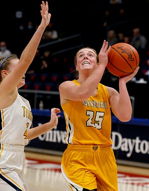 Waynedale guard Brooklyn Troyer scores against Ottawa-Glandorf guard Kelsey Erford during a Division III semifinal. Troyer finished with 16 points, six rebounds and four steals to cap off her high school career.
