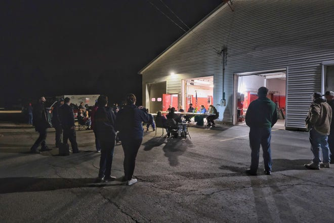 The Fairfield Township Board met outside the township fire hall Monday due to a large turnout that was expected. Approximately 40 people came to the meeting, most interested in the plight of the fire department.