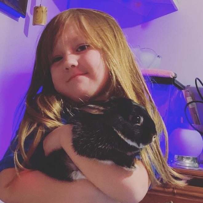 Kasie Share and her pet rabbit, 'Jake from State Farm'