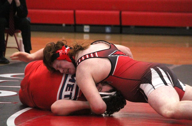 Coldwater's Kevin Hall Jr. holds on with all his strength on his way to a pin fall victory over Hanover Horton Wednesday