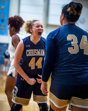 William Chrisman guard Amanda Szopinski (44) celebrates with teammate Jacque David (34) after scoring while getting fouled in their Class 5 sectional playoff at Grandview Wednesday. The senior duo combined for 32 points to lead the Bears to a 48-36 win and into Saturday's state quarterfinal against Smithville.