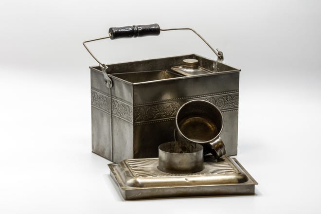 A miner's lunch tin, an Out of the Attic item, is shown at the Des Moines County Historical Society, 504 N. Fourth St., in Burlington.