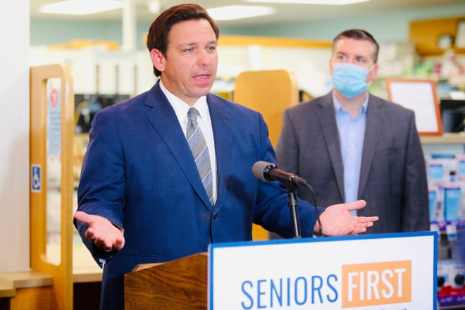 Gov. Ron DeSantis talks about vaccination plans during a news conferenced this month in Lee County.