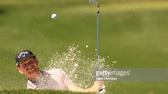 Tyler McCumber hits out of a bunker on the eighth hole during the first round of The Players Championship at the Players Stadium Course at TPC Sawgrass. (Photo by Mike Ehrmann/Getty Images)