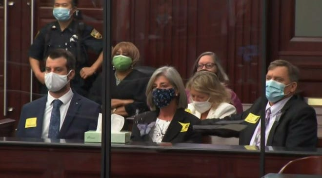(Left to right) Savannah Gold's brother Chris, mother Sharon and father Dan sit in the courtroom as the 40-year-sentence against her killer is handed down.