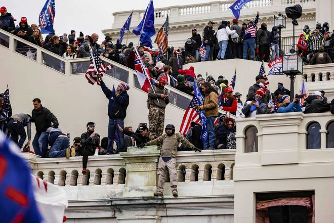 Pro-Trump supporters storm the U.S. Capitol following a rally with President Donald Trump on Jan. 6, Washington, D.C. This week, an Edgewater man, Howard Berton Adams, 60, was arrested on charges stemming from the riot.