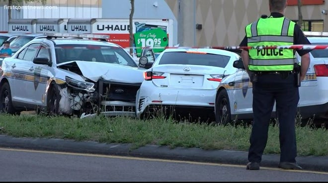 This is the stolen Lexus sedan at Wednesday's crash scene on 103rd Street between two police cruisers so the credit union robbery suspect could be apprehended.