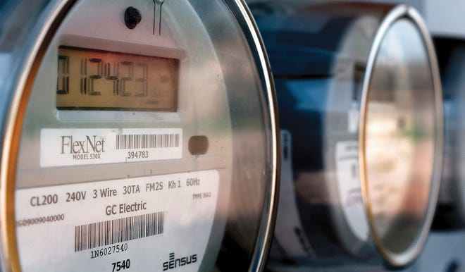 Digital electric meters run for a group of Garden City residences. The Garden City Commission approved Tuesday for the city to apply for the state of Kansas' utility low-interest loan program.