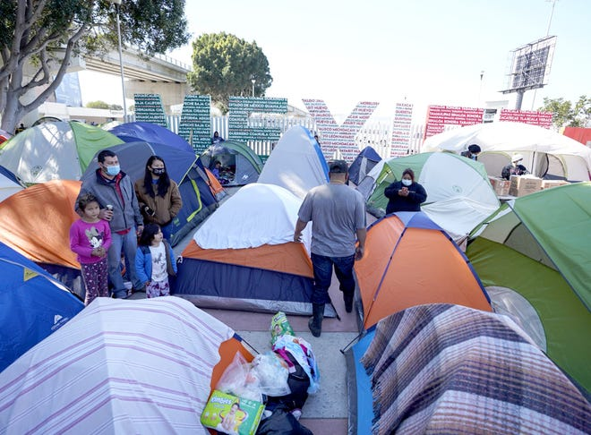 Asylum-seekers have set up tents as they settle in at El Chaparral port of entry on Feb. 24, 2021, in Tijuana, Mexico.