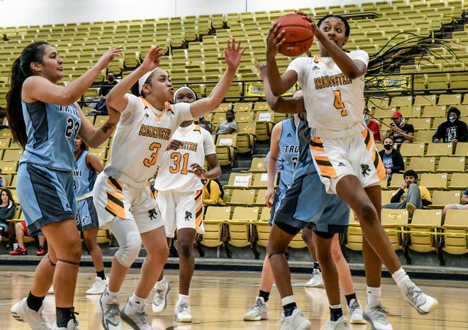 Garden City Community College's Taylor Lawhorne, right, grabs an offensive rebound and puts it back up for a basket Wednesday against Colby at Perryman Athletic Complex. Also shown on the play for the Broncbusters is Alexis Smith (3) and Donetria McGee (31).