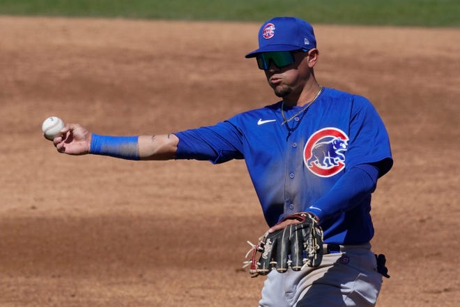 Chicago Cubs second baseman Ildemaro Vargas throws to first during the second inning of a spring training game Saturday, March 6, in Phoenix.