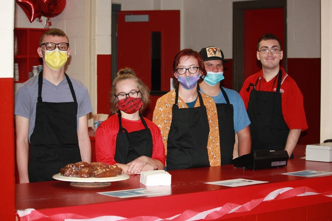 From left, Garrett Ratliff, Shealyn Melton, Darla Stinchcomb, Colton Lane and Isaiah McGowan stand at the ready to help customers at Tuffy's Morning Boost, a coffee shop that just opened at Glen Rose HS.