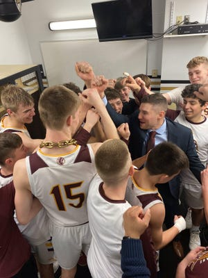 The Hays High boys basketball team celebrates after beating Topeka Highland Park in the 2020 Class 5A quarterfinals in Emporia. A day later, the Indians' season ended abruptly when the tournament was canceled because of the COVID-19 pandemic.